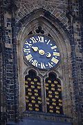 Clock on the front of St. Vitus's Cathedral in Prague Castle, Prague, Czech Republic. The castle, first constructed in the 10th century is the seat of government in the Czech Republic.
