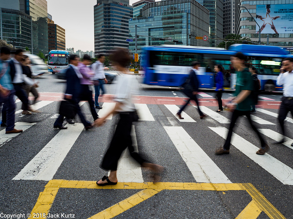 08 JUNE 2018 - SEOUL, SOUTH KOREA:  A slow shutter motion blur photo of pedestrians cross Namdaemun Ro in Seoul.      PHOTO BY JACK KURTZ
