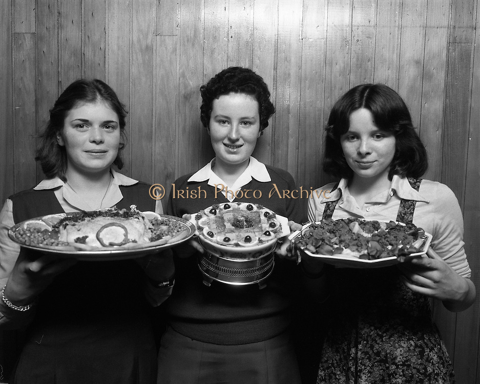 "Seafood Cook in Rosslare 07/05/1976.05/07/1976.7th May 1976.Pictured L-R, Siobhan Neeson, (15 years), 2nd prize, St. Louis Convent, Monaghan with her dish, ""Hot Peppered Cod"", Yvonne Cooney, (15 years), Dominican Convent, Muckross Park, Dublin, the winner with her dish, ""Cod Pancake Casserole"", and Judy Tormey, (16) St. Joseph's College, Summerhill, Athlone, Co. Westmeath, 3rd prize, with her dish ""Devilled Cod"""