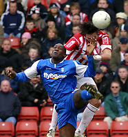 Photo: Dave Linney.<br />Stoke City v Birmingham City. The FA Cup. 19/02/2006.<br />Stoke's Carl Hoefkens(R) beats  Emile Heskey to the ball