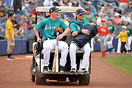 PEORIA, AZ - MARCH 05:  Kyle Seager #15 and Shawn O'Malley #36 of the Seattle Mariners ride to the field on a golf cart prior to the spring training game against the Oakland Athletics at Peoria Stadium on March 5, 2017 in Peoria, Arizona.  (Photo by Jennifer Stewart/Getty Images)