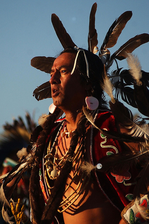 POST FALLS, ID - JULY 23:  A Native American dances in the grand entry of the Julyamsh Pow Wow in Post Falls, Idaho on Friday. The Julyamsh is touted as the largest pow wow in the Northwest.