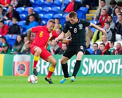 Craig Bellamy of Wales (Cardiff City) turns on the ball to avoid James McCarthy of Republic of Ireland (Wigan Athletic)  - Photo mandatory by-line: Dougie Allward/JMP - Tel: Mobile: 07966 386802 14/08/2013 - SPORT - FOOTBALL - Cardiff City Stadium - Cardiff -  Wales V Republic of Ireland - International Friendly