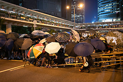 Hong Kong. 4 October 2019. Large gathering of pro- democracy supporters evening in Hong Kong Central District. Protestors angry with Chief Executive Carrie Lam's use of Emergency Powers to ban the wearing of masks during protests. March proceeded peacefully towards Wanchai district. Pic. Attempt at barricade on highway by protestors. Iain Masterton/Alamy Live News.