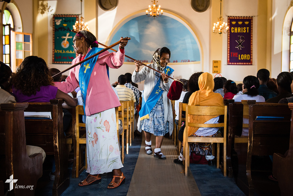Ladies handle offering during worship at the EECMY Mother Church in Addis Ababa, Ethiopia, on Sunday, Nov. 9, 2014. LCMS Communications/Erik M. Lunsford