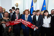 Anna Komorowska First Lady of Republic Poland poses with disability athletes to family photo during 30 years anniversary of The Special Olympics Poland at Presidential Palace in Warsaw on March 18, 2015.<br /> <br /> Poland, Warsaw, March 18, 2015<br /> <br /> For editorial use only. Any commercial or promotional use requires permission.<br /> <br /> Mandatory credit:<br /> Photo by © Adam Nurkiewicz / Mediasport