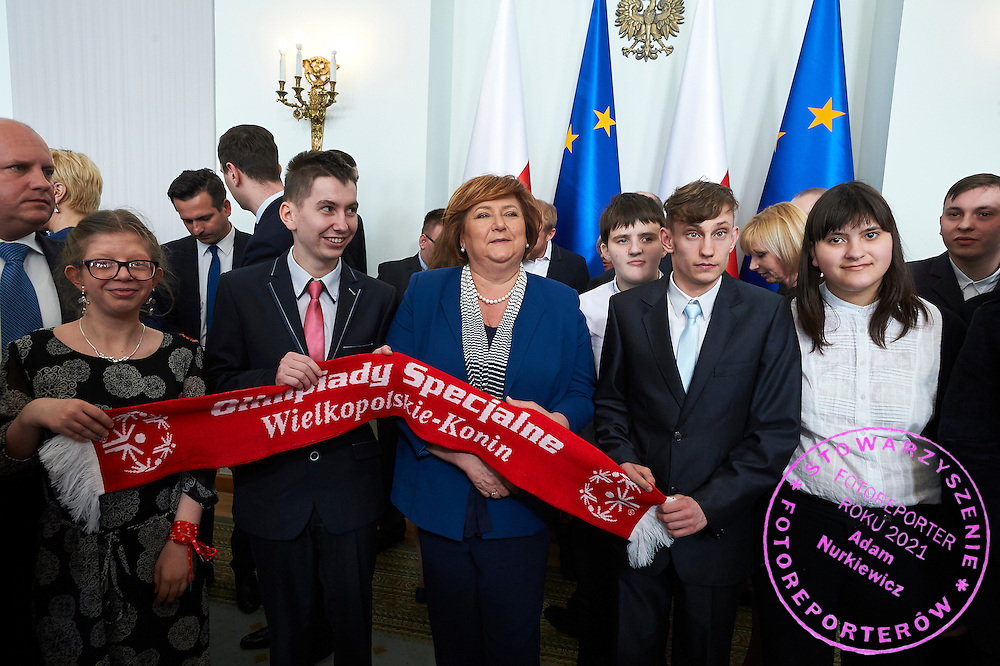 Anna Komorowska First Lady of Republic Poland poses with disability athletes to family photo during 30 years anniversary of The Special Olympics Poland at Presidential Palace in Warsaw on March 18, 2015.<br /> <br /> Poland, Warsaw, March 18, 2015<br /> <br /> For editorial use only. Any commercial or promotional use requires permission.<br /> <br /> Mandatory credit:<br /> Photo by &copy; Adam Nurkiewicz / Mediasport