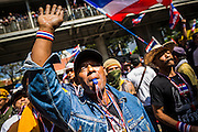 "14 JANUARY 2014 - BANGKOK, THAILAND:  Anti-government protestors blow their whistles in front of Royal Thai Police headquarters. The whistle has emerged as the protestors' main weapon against the government. Hundreds of protestors picketed police headquarters because they accuse the police of siding with the government during the protests. Tens of thousands of Thai anti-government protestors continued to block the streets of Bangkok Tuesday to shut down the Thai capitol. The protest, ""Shutdown Bangkok,"" is expected to last at least a week. Shutdown Bangkok is organized by People's Democratic Reform Committee (PRDC). It's a continuation of protests that started in early November. There have been shootings almost every night at different protests sites around Bangkok, but so far Shutdown Bangkok has been peaceful. The malls in Bangkok are still open but many other businesses are closed and mass transit is swamped with both protestors and people who had to use mass transit because the roads were blocked.    PHOTO BY JACK KURTZ"