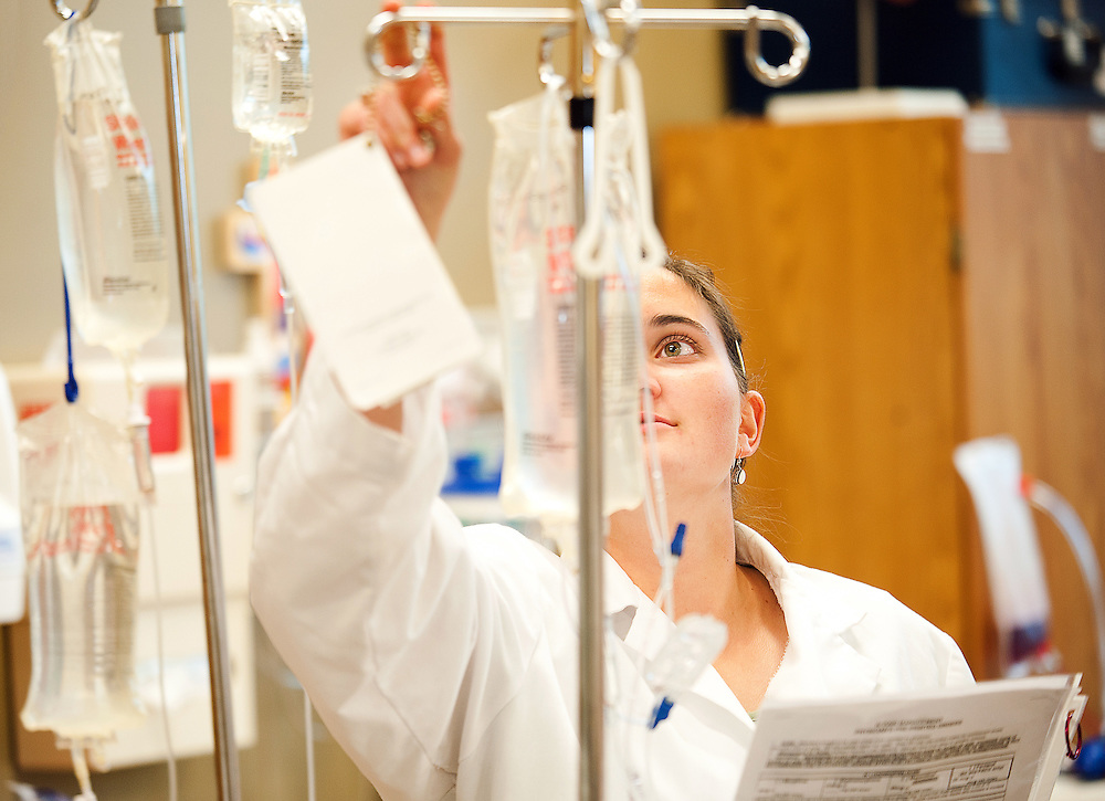 A BSN Student monitors IVs in our Sim Lab. (Photo by Rajah Bose)