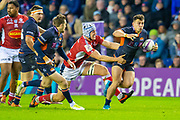 Damien Hoyland (#15) of Edinburgh Rugby looks to break the tackle of Pierce Phillips (#4) of SU Agen Rugby during the European Rugby Challenge Cup match between Edinburgh Rugby and SU Agen at BT Murrayfield, Edinburgh, Scotland on 18 January 2020.