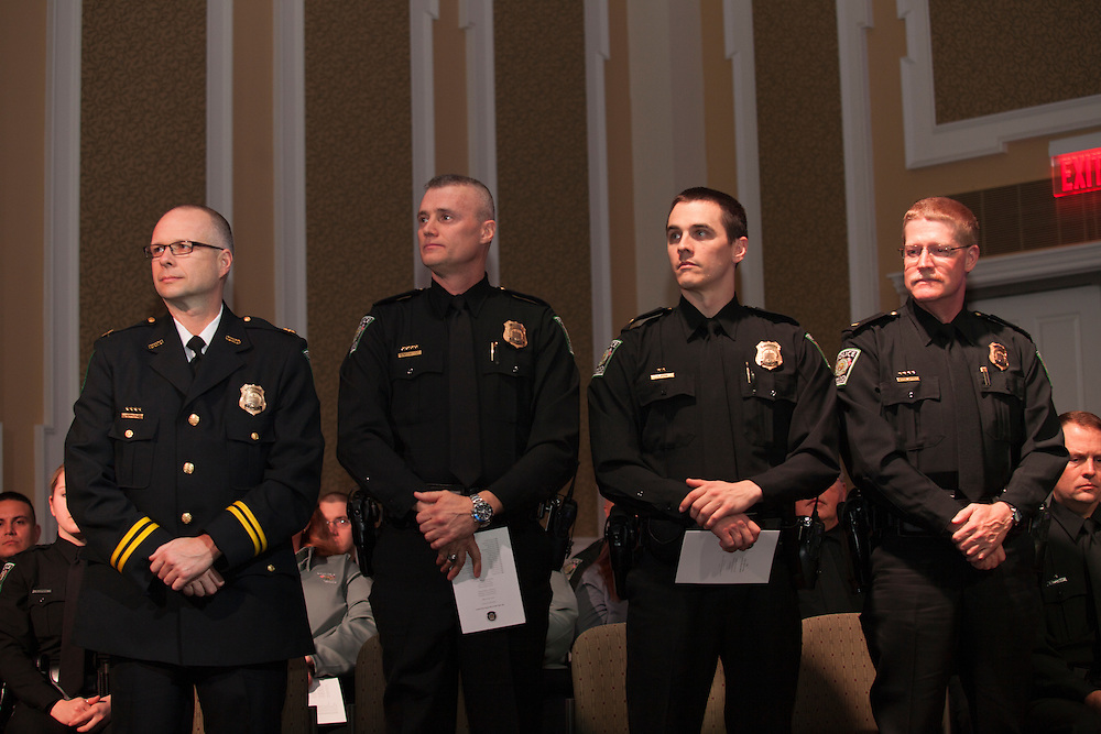 (Left to right) Capt. Brian Kapple, Lt. Eric Hoskinson, Lt. Tim Ryan, and Lt. Brian Newvahner are recognized at the Badge Pinning and Employee Recognition Ceremony on Monday, February 8, 2016. Photo by Kaitlin Owens