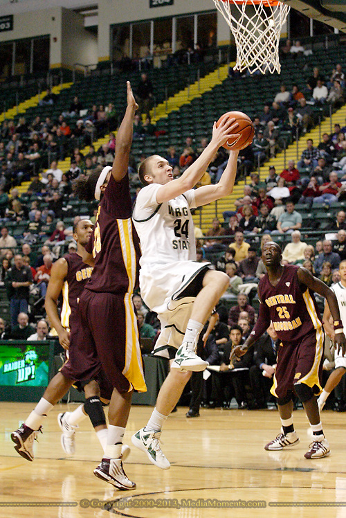 CMU junior Oliver Mbaigoto (25) watches WSU sophomore Matt Vest (24) at the basket as the Central Michigan Chippewas play the Wright State University Raiders at the Nutter Center, Thursday, December 22, 2011.