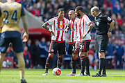 Sunderland's Midfielder Wahbi Khazri (22)prepares to take free kick  watched by Sunderland's Midfielder Yann M'Vila (21) and Sunderland's Goalkeeper Steve Harper (33) during the Barclays Premier League match between Sunderland and Arsenal at the Stadium Of Light, Sunderland, England on 24 April 2016. Photo by George Ledger.