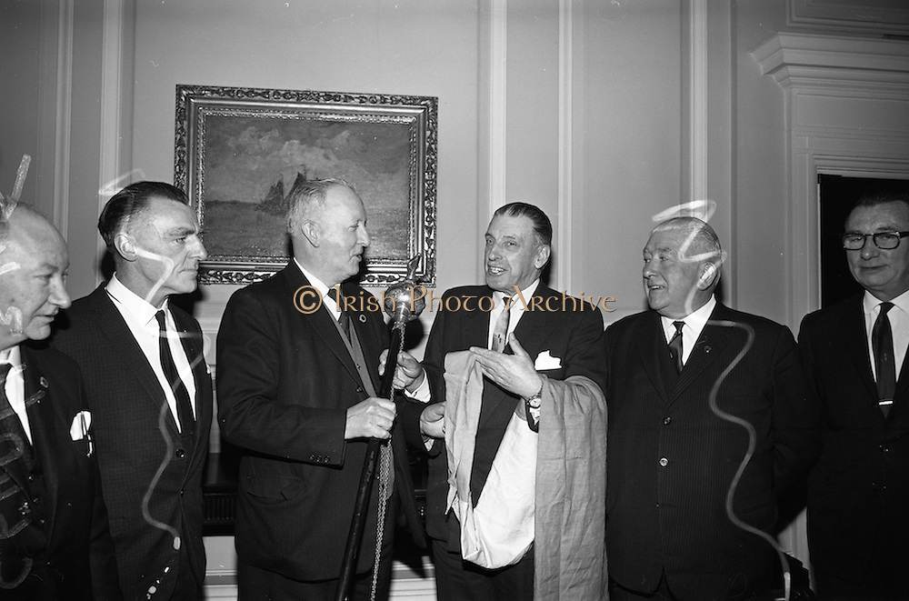 03/04/1966<br /> 04/03/1966<br /> 03 April 1966<br /> Taoiseach Sean Lemass presents staff and pennon for Liberty Hall. the tricolour pennon and band-master's staff were taken by a British officer from Liberty Hall during the 1916 Rising. A brother of the officer gave the items to Dr. Edward P. Carey of London in 1952 who presented them to Eamon de Valera who in turn presented them to the National Museum. Picture shows Mr. Lemass (third from right) handing over the staff and pennon to (from left) Mr. Patrick O'Brien, National Trustee; Mr. Jack Brady, National Trustee; Mr. Edward Browne, Vice President; Mr. John Conroy, General President of the Union; Mr. Edward Browne, Vice President and Mr. Fintan Kennedy, General Secretary, I.T.G.W.U..
