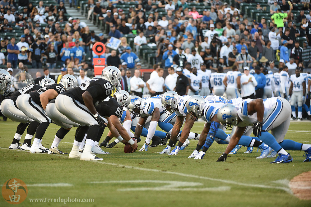 August 15, 2014; Oakland, CA, USA; General view of the line of scrimmage between the Oakland Raiders and the Detroit Lions during the first quarter at O.co Coliseum.