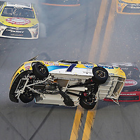 Regan Smith (7) flips on the front stretch during the Alert Today Florida 300 XFinity Series race at Daytona International Speedway on Saturday, February 21, 2015 in Daytona Beach, Florida.  (AP Photo/Alex Menendez)