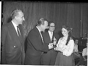 07/11/1959<br /> 11/07/1959<br /> 07 November 1959<br /> All Ireland Final of Gael Linn Children's Singing Competition at Francis  Xavier Hall, Dublin. Picture shows Sean Ó Siothchain (second from left) Assistant Secretary of the GAA and Trustee of Gael Linn, presenting the 1st prize of a solid silver cup to Aine Ní Rinn (16), Sraid A Mhuillinn, Co. Chorcaigh. Also in the picture are the adjudicators, Proinsias ÓCeallaigh (left) and Seoirse Bodlai.