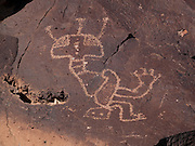 "One of the more unusual petroglyphs found along the Rinconada Canyon trail in Petroglyph National Monument suggests a mythical being with two feet and no arms.  Do the three ""antennae"" signify shamanic power of communication with spirits?"
