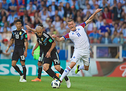 MOSCOW, RUSSIA - Saturday, June 16, 2018: Argentina's Javier Mascherano (left) and Iceland's Alfred Finnbogason (right) during the FIFA World Cup Russia 2018 Group D match between Argentina and Iceland at the Spartak Stadium. (Pic by David Rawcliffe/Propaganda)