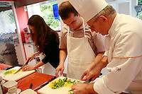 "Lenotre Ecole Culinaire, Paris,..short course - ""Return to the Market"" with Chef Jacky Legras..slicing peppers...photo by Owen Franken for the NY Times..July 12, 2007......."