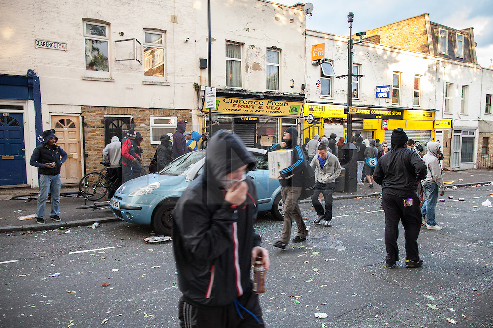 © Licensed to London News Pictures . 08/08/2011 . London , UK . Looters raid the Clarence Convenience Store on Clarence Road on the Pembury Estate in Hackney during a 3rd night of rioting and looting in London , which followed a protest against the police shooting of Mark Duggan in Tottenham . Photo credit : Joel Goodman/LNP
