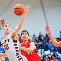 Grants Pirate Richie Lucero (32) reaches for a pass ahead of  Academy Charger Max Preissler (32) in Grants Tuesday.