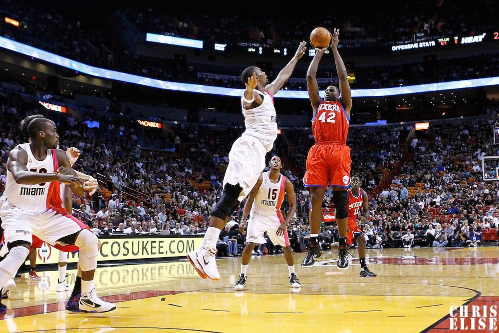 21 January 2012: Philadelphia Sixers power forward Elton Brand (42) takes a jumpshot over Miami Heat power forward Chris Bosh (1) during the Miami Heat 113-92 victory over the Philadelphia Sixers at the AmericanAirlines Arena, Miami, Florida, USA.