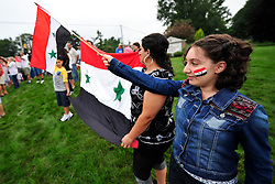 Members of the local Syrian community rally after President Obama's afternoon press conference on the United States' possible actions in Syria, Saturday, August 31, 2013 in Allentown, PA. (AP Photo/Chris Post)