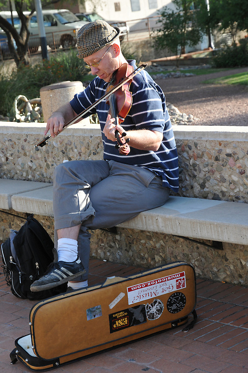 Musician rehearsing at the 2011 Tucson Folk Festival. Event photography by Martha Retallick.