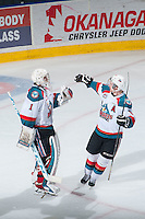 KELOWNA, CANADA - MARCH 27: Colten Martin #8 congratulates Jackson Whistle #1 of Kelowna Rockets on the win and shutout against the Tri-City Americans on March 27, 2015 at Prospera Place in Kelowna, British Columbia, Canada.  (Photo by Marissa Baecker/Shoot the Breeze)  *** Local Caption *** Jackson Whistle; Colten Martin;