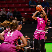 10 February 2018: The San Diego State Aztecs women's basketball team hosts Nevada on Play4Kay day at Viejas Arena. San Diego State Aztecs guard Cheyenne Greenhouse (30) attempts a jump shot over a Nevada defender in the second half. The Aztecs beat the Wolfpack 75-72. <br /> More game action at www.sdsuaztecphotos.com