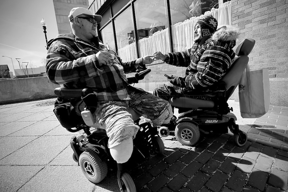 Carlos Raposa, right, bums a cigarette from Richard Sterne who he ran into on his way to meed his father at the club. Like Carlos, Mr. Sterne has also lost both of his legs due to diabetes. Carlos Raposa, 49, has lost both of his lower legs because of diabetes and struggles to deal with the commitment of getting dialysis for 3 hours 3 times a week.  As his condition has worstened over the years Carlos has had greater difficulty dealing with his condition.  Increasingly, Carlos has fallen greater into depression and has turned to smoking and drinking to deal with it.  What used to be monthly visits to the hospital has turned into weekly excursions with ever longer stays in hospital.  Family members have become ever more worried about Carlos' drop in weight and his inability to move on his own any longer.  For someone who was an athletic figure, Carlos has become a shadow of his former self.