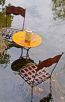 Submerged metal chairs and table at Isles-sur-la Sorgue, France.