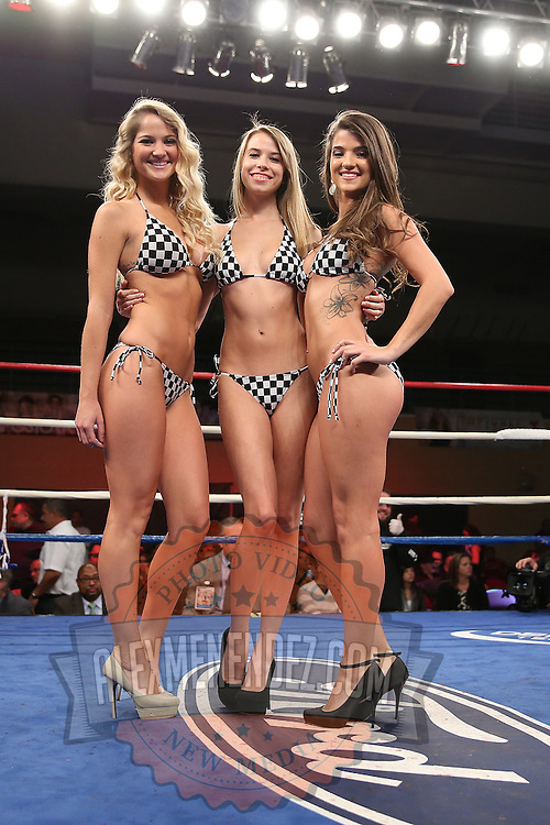 """Ring girls are seen during the """"Boxeo Telemundo"""" boxing match at the Kissimmee Civic Center on Friday, March 14, 2014 in Kissimmme, Florida. (Photo/Alex Menendez)"""