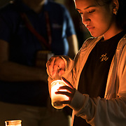Memorial vigil for the 17 people killed at Marjory Stoneman Douglas High School by Nikolas Cruz using a semiautomatic AR-15 rifle. Mourners visit the 17 white crosses standing in a field in memory of each victim, 14 students and 3 faculty members. <br /> Photography by Jose More