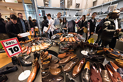 © Licensed to London News Pictures. 26/12/2016. Customers in the mens shoe department of Selfridges store in Oxford Street for the start of the stores Boxing Day sales. London, UK. Photo credit: Ray Tang/LNP