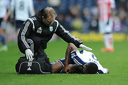 West Bromwich Albion's Brown Ideye goes down injured. - Photo mandatory by-line: Dougie Allward/JMP - Mobile: 07966 386802 - 14/03/2015 - SPORT - Football - Birmingham - The Hawthorns - West Bromwich Albion v Stoke City - Barclays Premier League
