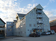 Waterside old warehouse wooden buildings harbour area, Tromso, Norway
