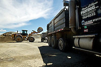 A front loader pours material into the a trailer bed Wednesday at Coeur d'Alene Paving's facility near Rathdrum. Coeur d'Alene Paving is requesting a permit and zone change in order to relocate its asphalt batch plant from its Highway 53 location to a site near the Stateline Speedway.