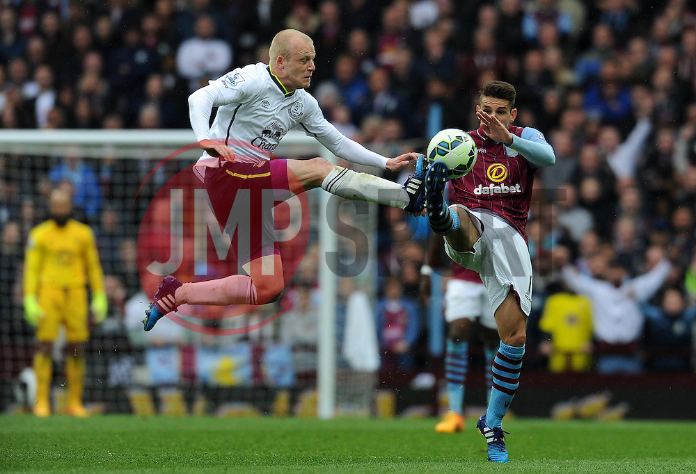 Aston Villa's Ashley Westwood challenges for the high ball with Everton's Steven Naismith - Photo mandatory by-line: Harry Trump/JMP - Mobile: 07966 386802 - 29/04/15 - SPORT - FOOTBALL - Birmingham - Villa Park - Aston Villa v Everton - Barclays Premier League