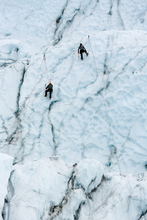 Ice climbers scaling terminus of Matanuska Glacier in Southcentral Alaska. Spring. Afternoon.