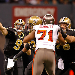 January 2, 2011; New Orleans, LA, USA; New Orleans Saints quarterback Drew Brees (9) passes against the Tampa Bay Buccaneers during the second quarter at the Louisiana Superdome. Mandatory Credit: Derick E. Hingle
