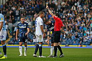 Referee Darren England shows a yellow card to Blackburn Rovers Jack Rodwell  during the EFL Sky Bet Championship match between Blackburn Rovers and Leeds United at Ewood Park, Blackburn, England on 20 October 2018.