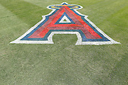 ANAHEIM, CA - JULY 10:  The logo of the Los Angeles Angels of Anaheim is painted on the grass during the game against the Seattle Mariners on July 10, 2011 at Angel Stadium in Anaheim, California. (Photo by Paul Spinelli/MLB Photos via Getty Images)