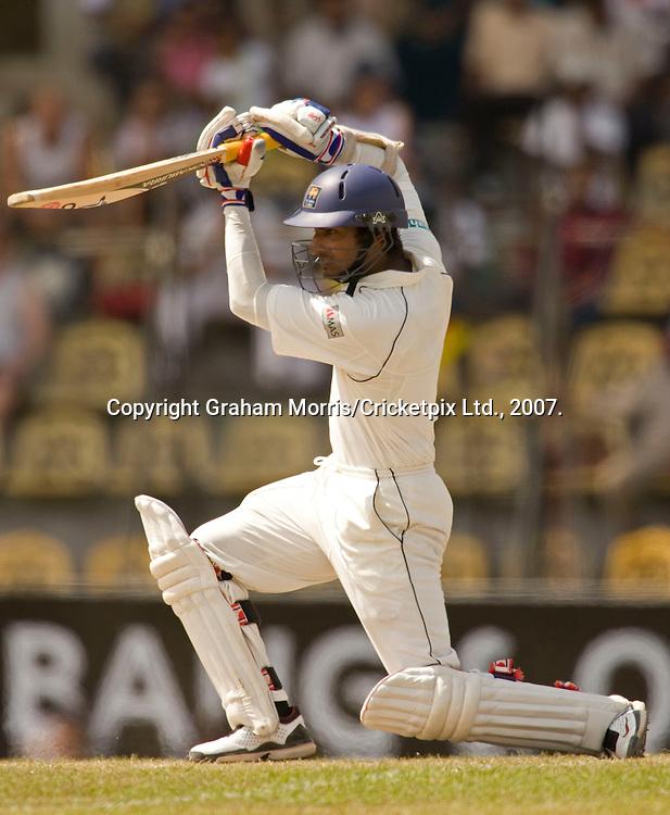 Kumar Sangakkara drives Ryan Sidebottom for four on the way to his fourth consecutive Test 150 during the first Test Match between Sri Lanka and England at the Asgiriya Stadium, Kandy. Photograph © Graham Morris/cricketpix.com (Tel: +44 (0)20 8969 4192; Email: sales@cricketpix.com)