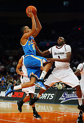 Nov 21, 2008; New York, NY, USA; UCLA Bruins guard Jerime Anderson (5) takes a shot over Southern Illinois Salukis guard Kevin Dillard (1) during second half action of the 2K Sports Classic consolation game at Madison Square Garden. UCLA defeated Southern Illinois 77-60.