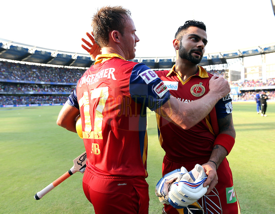 Royal Challengers Bangalore captain Virat Kohli  hugs Royal Challengers Bangalore player AB De Villiers as the walk back after the first innings of the match 46 of the Pepsi IPL 2015 (Indian Premier League) between The Mumbai Indians and The Royal Challengers Bangalore held at the Wankhede Stadium in Mumbai, India on the 10th May 2015.<br /> <br /> Photo by:  Sandeep Shetty / SPORTZPICS / IPL