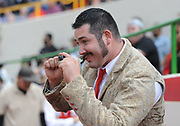 BEA AHBECK/NEWS-SENTINEL<br /> Amadores Luso Americanos de Turlock's Ryan 'Chops' Zavalaposes with a small camera during the bloodless bullfight during the Our Lady of Fatima Portuguese Festival in Thornton Saturday, Oct. 15, 2016.