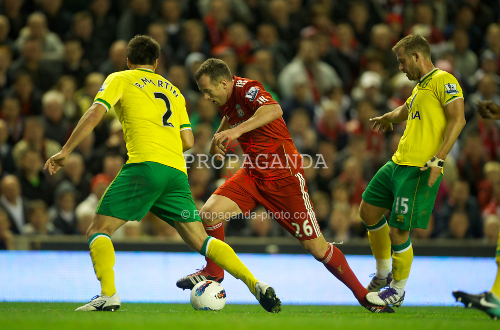 LIVERPOOL, ENGLAND - Saturday, October 22, 2011: Liverpool's Charlie Adam is tackled by Norwich City's David Fox during the Premiership match at Anfield. (Pic by David Rawcliffe/Propaganda)