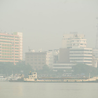 Jan 13, 2013 -  A view of office and resident buildings across Ganges River in Kolkata, India.  The pollution measurements are 20% to 50% higher than safe limits at many parts of the city.<br /> <br /> Story Summary: It is said that the battle over global warming is to be won or lost in Asia. With growing populations and new economic boom in the global markets across Asia countries like India, Nepal and Cambodia have to grapple with the success and the environmental disaster that comes with ramped up production in unchecked or unregulated industries to compete in todays marketplace. The catastrophic air pollution makes for new problems to be dealt with such as a future health crisis, quality of life issues and the tarnished image of reduced visibility to world heritage sites for tourism.